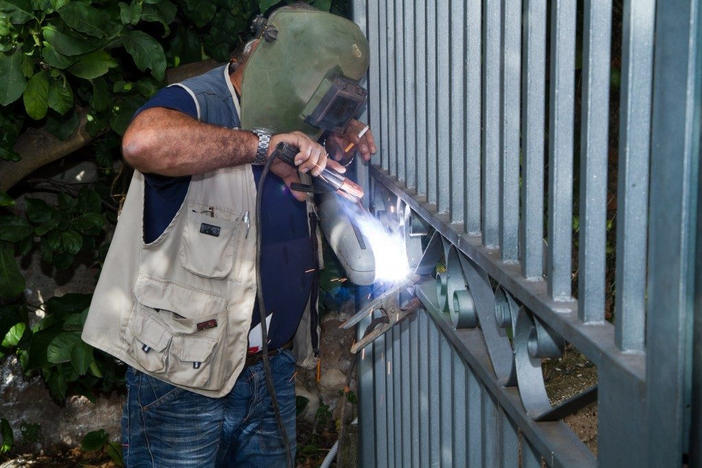 Metalworker welding a gate