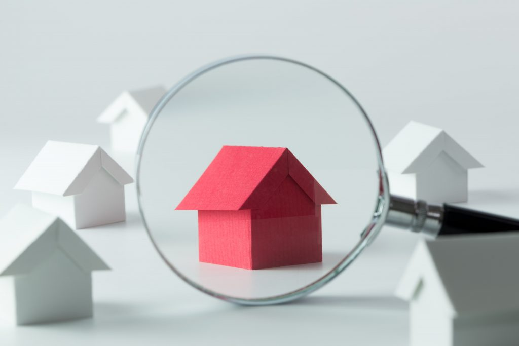 magnifying glass focusing in a red-colored home