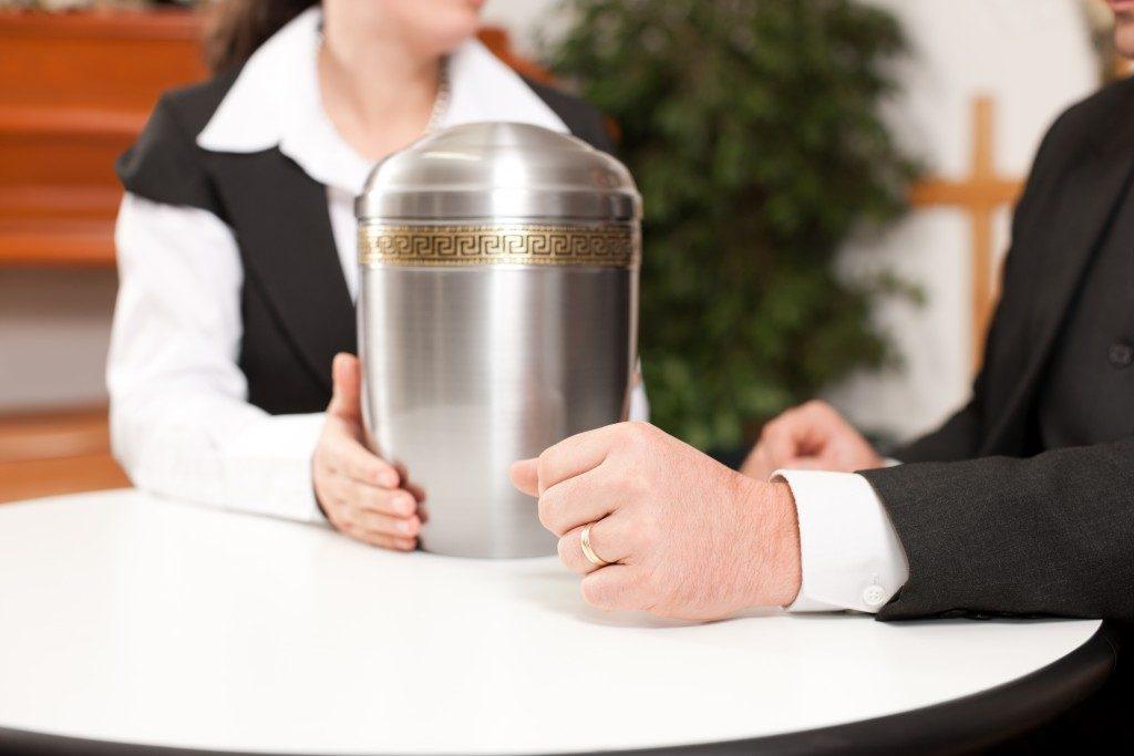 holding an urn
