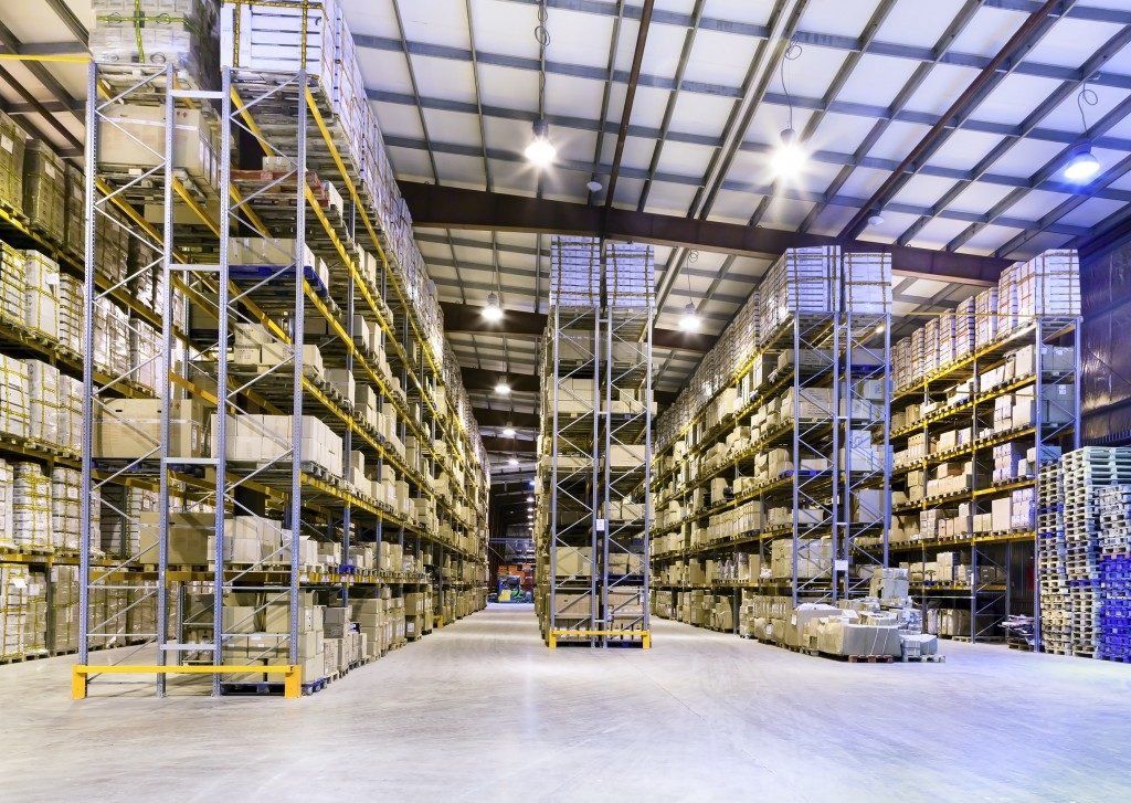Interior of new large and modern and well-lit warehouse space