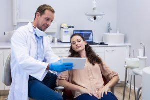 Dentist guiding a patient