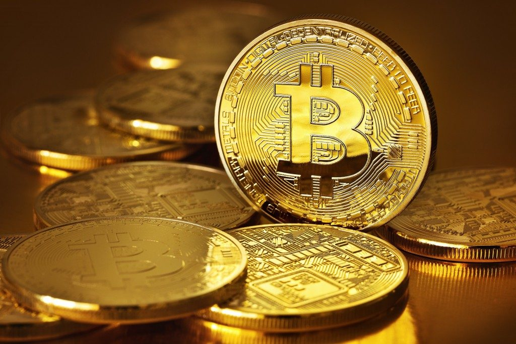 Golden Bitcoins on a gold background