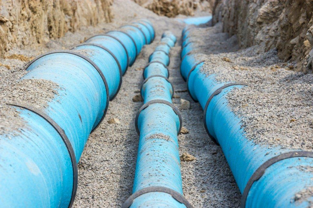 Three blue pipelines
