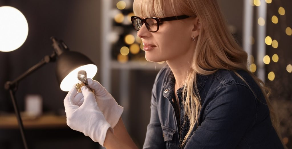 woman preparing custom jewel