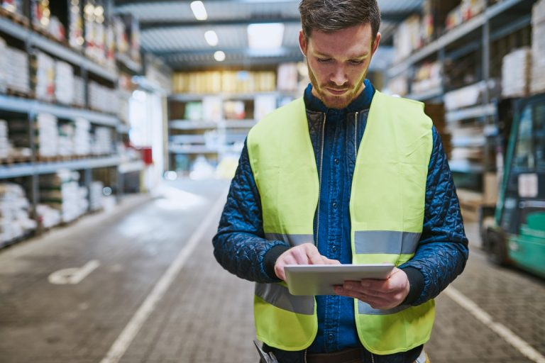 Man using tablet in inventory