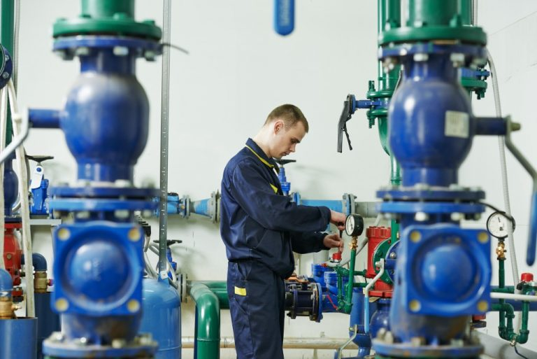 Engineer checking pumps
