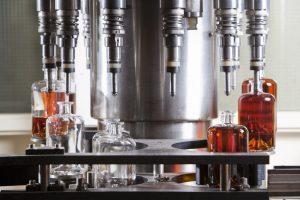 Machine filling bottles