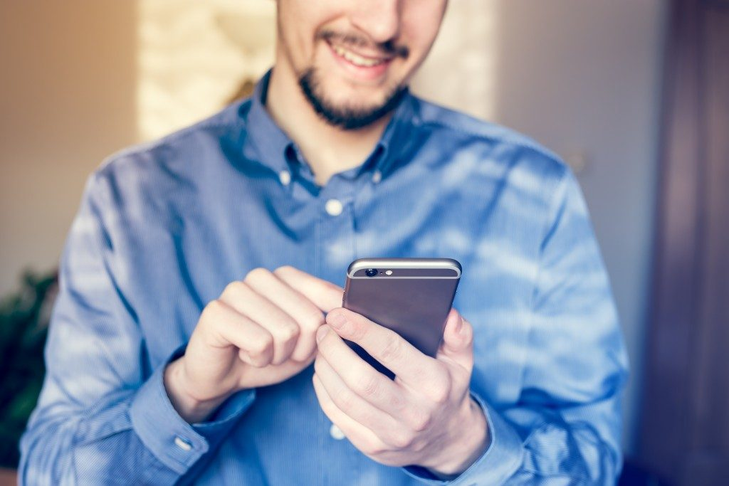 Businessman working on smartphone