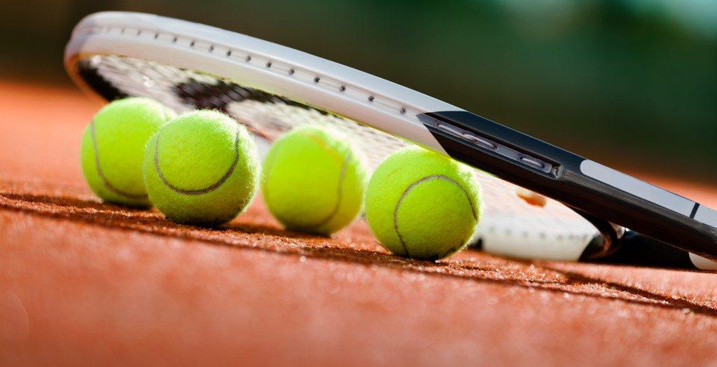 green woolen badminton balls and a racket