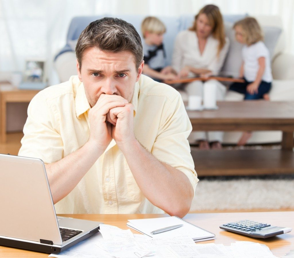 Worried father computing their bills
