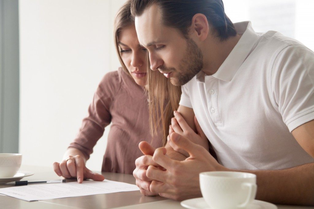 Couple looking at important document