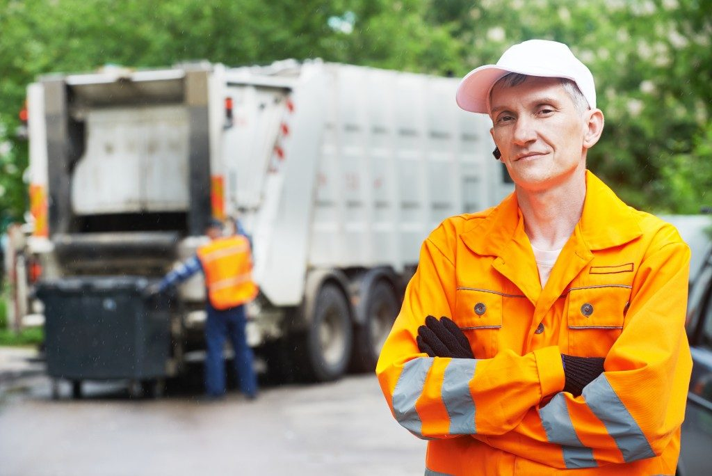 workers for waste management company
