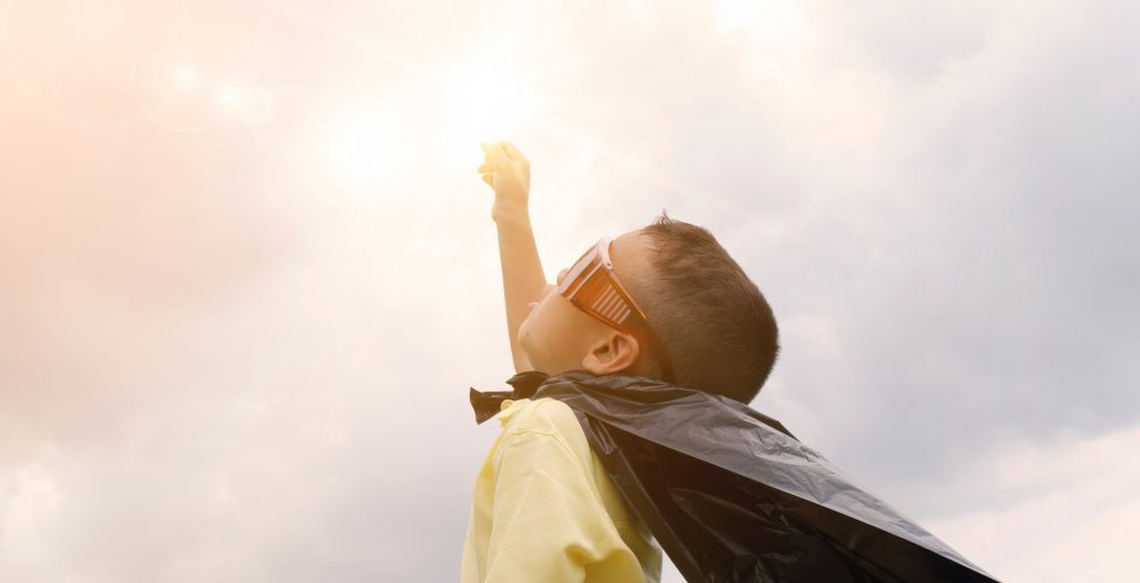 Boy wearing cape and shades