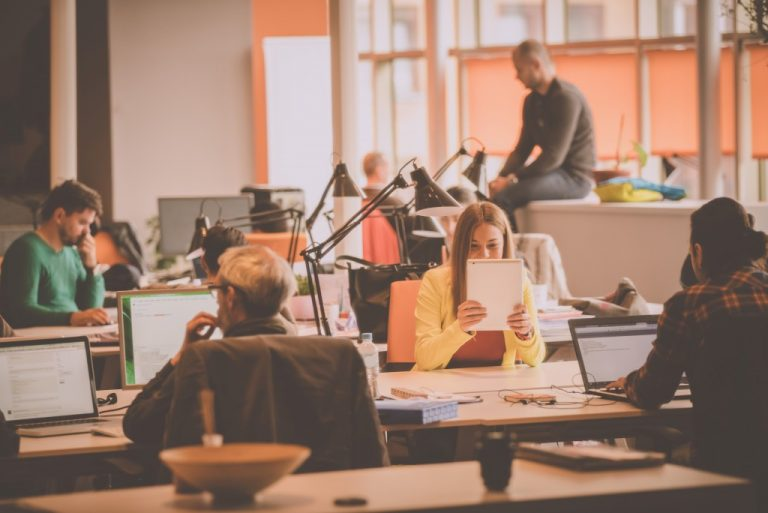employees working at a modern coworking space