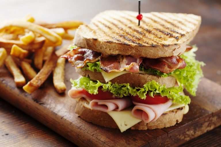 delicious sandwich with fries on the side