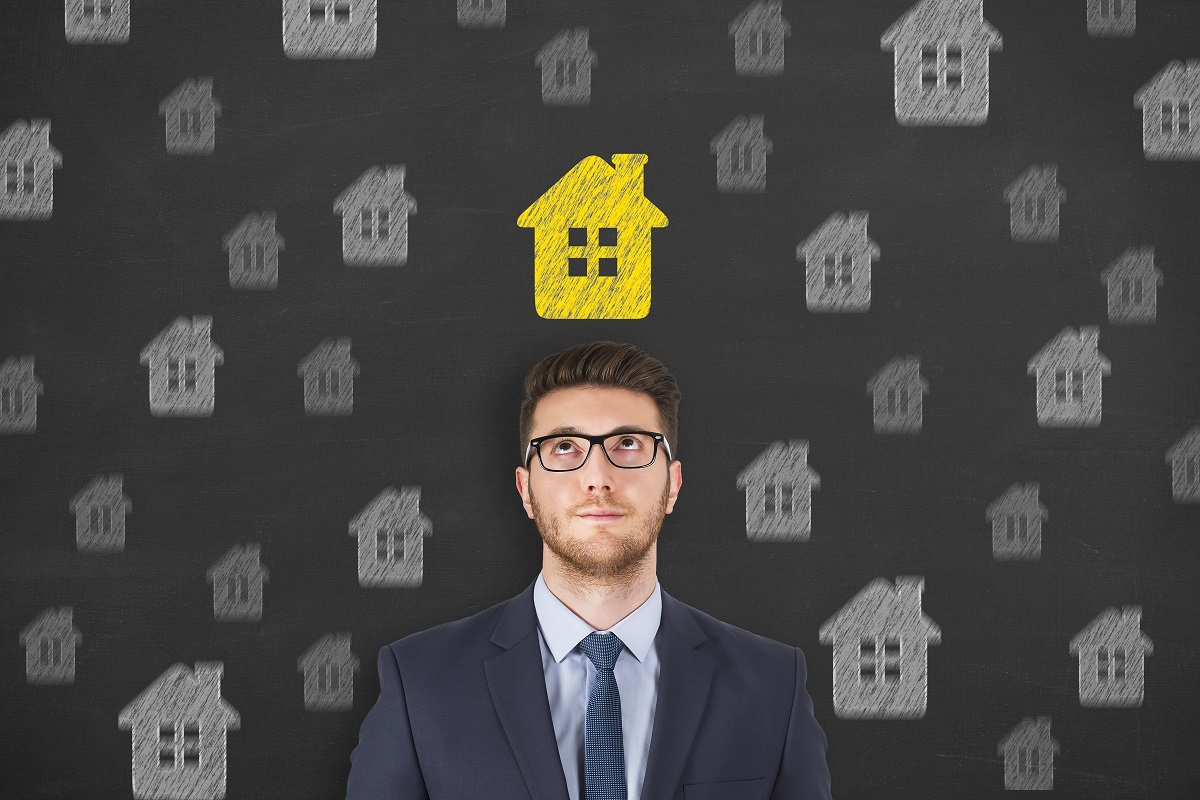 man with yellow house above his head