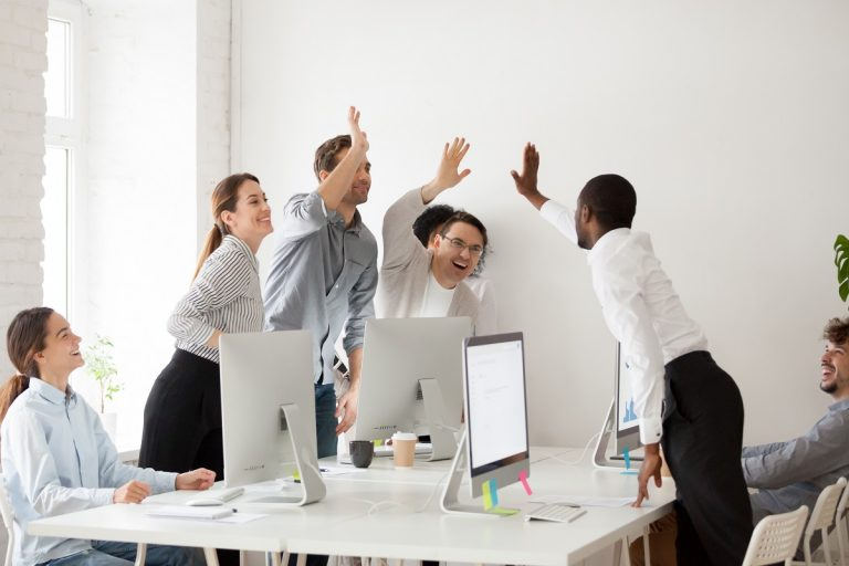 team giving a high five