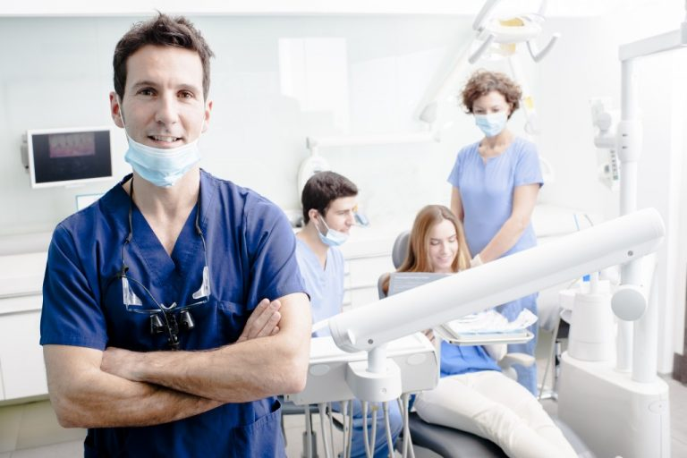dentist with his team
