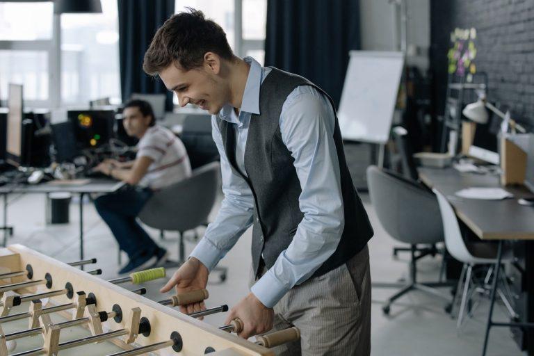 man playing foosball at work