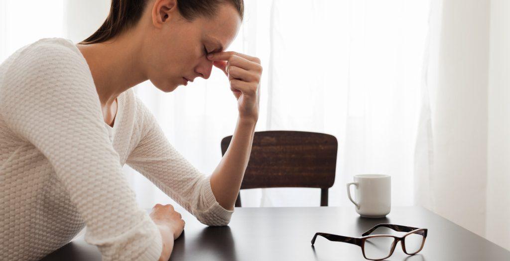 woman down on debt